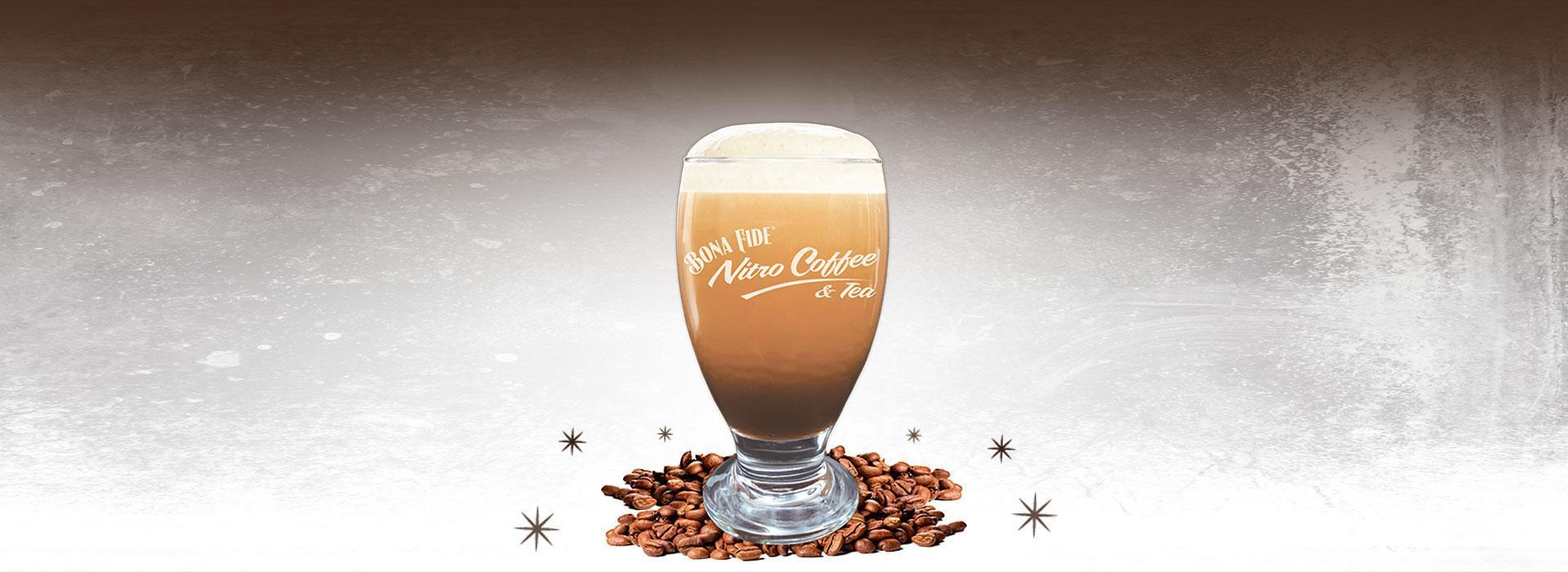 Nitro Coffee in glass with beans
