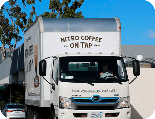 Coffee distrbutors deliver coffee kegs done by Bona Fide